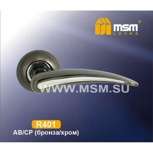 Ручки на кругл. накладке R401 AB/CP  (бронза/хром)