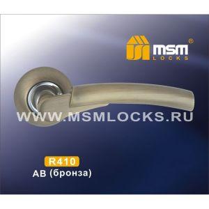 Ручки на кругл. накладке R410 AB/CP  (бронза/хром)