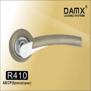 Ручки на кругл. накладке DAMX  R410 AB  (бронза)